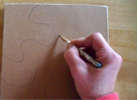 Use a pencil to mark the puzzle piece cuts.