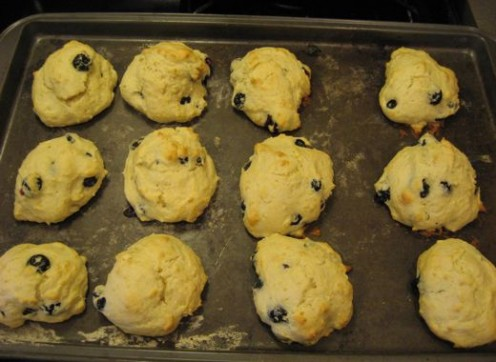 A tray of freshly baked blueberry biscuits.