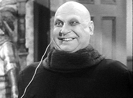 """Jackie Coogan as Uncle Fester in the 60's television series, """"The Adams Family"""""""