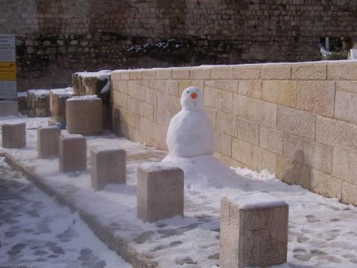 Snowman on street in Jerusalem