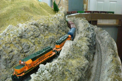 This BNSF frieght train travels through some stunning scenery at a recent operating session on Dave Waraxa's BNSF Kootenai River Sub railroad, a part of the RiverRail operations group in La Crosse, Wisconsin.