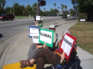 Protests by a busy intersection give drivers something to read and think about while they wait for the light to change.