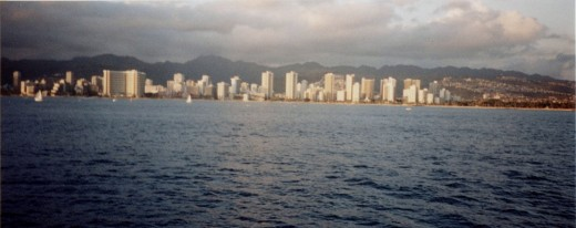 Part of my novel is set in Honolulu Hawaii.  Here is a picture I took of Waikiki Beach in 2002.