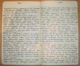A Moleskine notebook with written text