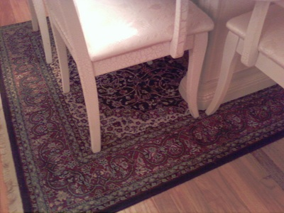 Put the smaller rug in the dining area and rotate the table