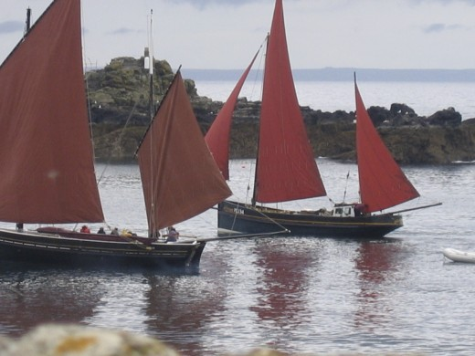 Old fishing luggers racing round the island in the bay.