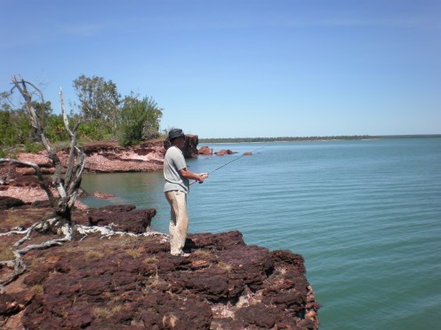 Rocky outcrop in deep blue water, Cape Don, Northern Territory, Australia
