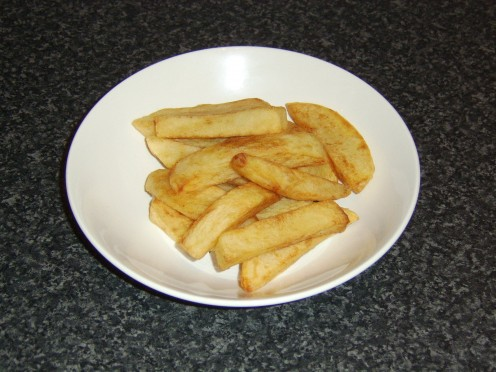 Chips in British English are similar to large French fries in American English - chips in American English are crisps in British English