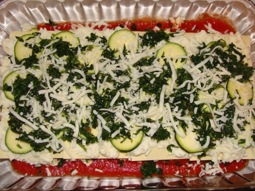 Sauce layered with noodles, cheese mixture, zucchini, spinach, and mozarella cheese.