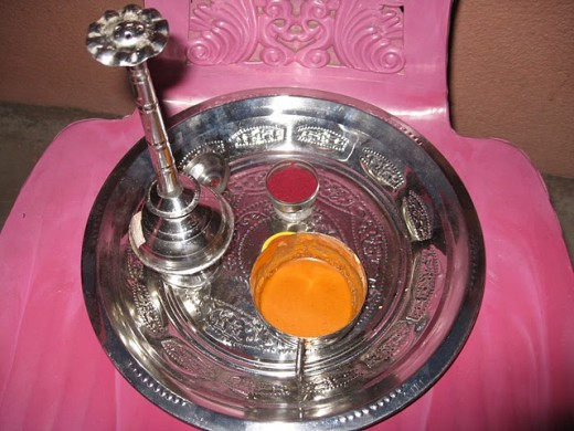 Rose water, sandalwood powder, and kumkum