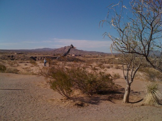 The Roadrunner Sentinel of Las Cruces with people to compare size.