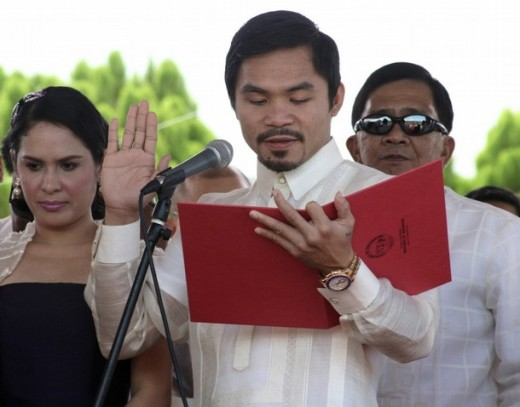 Manny Pacquiao takes his oath of office Image source: http://www.philippinestodayus.com/wp-content/uploads/2010/07/pacquiao1.jpg