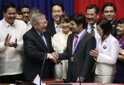 Manny Pacquiao receives the Congressional Medal of Achievement Image Source: http://2.bp.blogspot.com