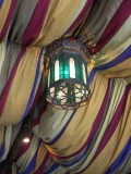 Soft but colorful lanterns emerge from lush draped material hanging overhead. CC lic: http://bit.ly/ItuRo