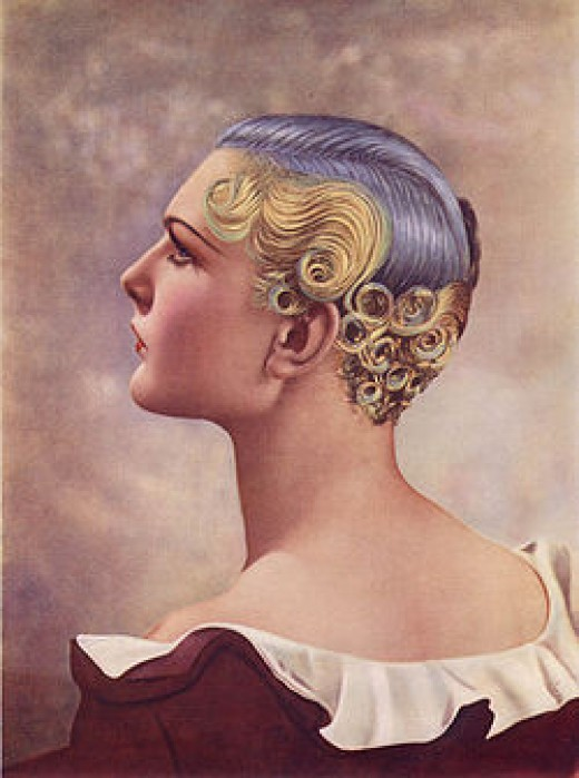 First Prize won at the Hairdressing Fashion Show London, 1935, using an Icall permanent-waving machine. The hair is shorter even than in the '20s and curls/waves are restricted to the back and sides, revealing the ears and neck. The colours were achi