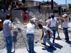 Helping neighbors build houses in Tijuana to combat homelessness.