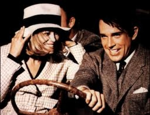 Faye Dunaway and Warren Beatty portraying  the infamous criminals, Bonnie Parker and Clyde Barrow (but the actors are about three times more attractive than the oiginal Bonnie and Clyde).