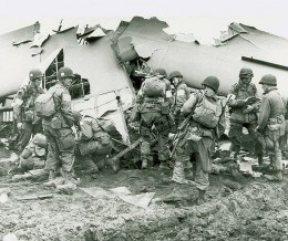 Members of the 101st Airborne inspecting a plane wreck. Easy Company wast part of the 101st Airborne.