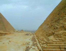 Tourists lend scale to the size of the Pyramids
