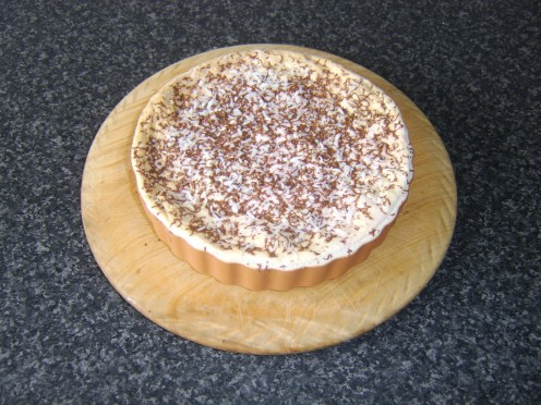 Chocolate is grated over the marshmallow and dessicated coconut is also added