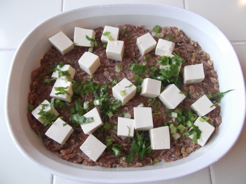 Add cubes of tofu and sprinkle chopped green onion and cilantro on top.