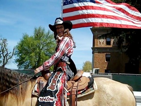 Kara, reigning Creston Classic Junior Rodeo Queen (2010), and her horse, Howie, proudly carry the flag.