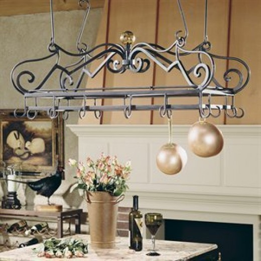 Between the ornate scroll work and the handblown glass finial, this gorgeous, overhead pot and pan rack will immediately attract the attention of anyone who enters your kitchen.