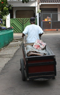 A door-to-door collector, hero in the front line of environment protection.