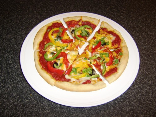 Mixed bell peppers and black olive pizza