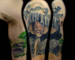 This is a composite of a Hakka Chinese half sleeve on the left arm. The left image is the inside view of the arm, which shows a traditional Hakka Village. The middle image is the side view of the arm, which shows a female Hakka farmer in traditional