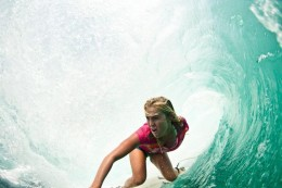 """Bethany surfing through a """"tube"""" also referred to as the """"green room"""" by surfers"""