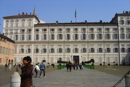 The front of Palazzo Reale, a royal home until the late 19th century. The interior is even more captivating. (In the background is my other half Debbie)