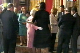 Big MIchelle puts her arm around the little queen.