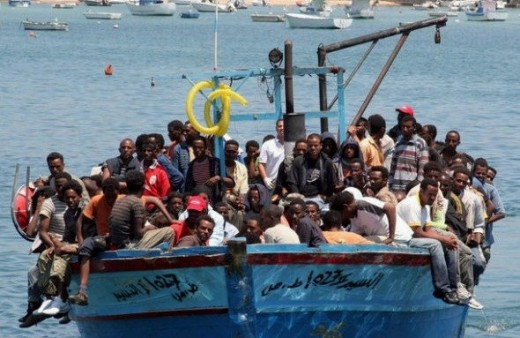 Overloaded boat. Where are the women:?