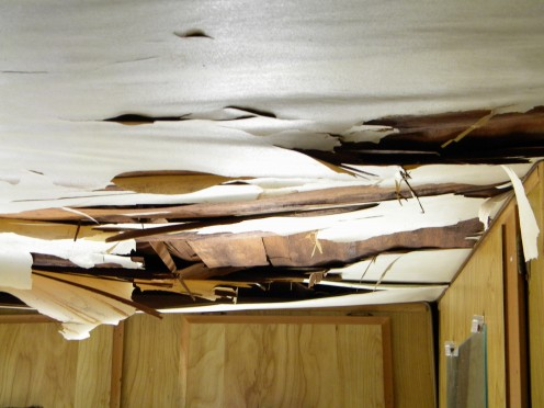 Damaged ceiling caused by leaking roof.  The entire ceiling needs recovering and bracing up.