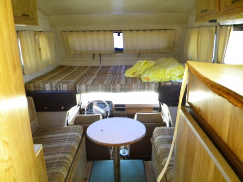 The walls and counter tops also would need recovering or replacing in the little motorhome.