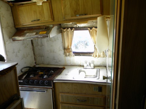 The stove and sink area is in pretty bad shape.  They and the cabinet will be removed to get to the rotten corner braces on the rear of the RV trailer.