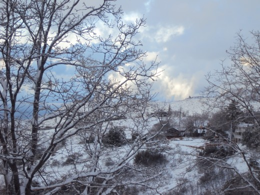 Looking down the hillside with snow.