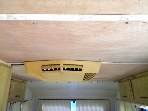 A view of the refurbished ceiling with the AC reinstalled.  Ready for painting.