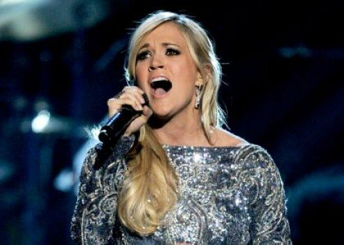 Carrie Underwood sings they hymn.
