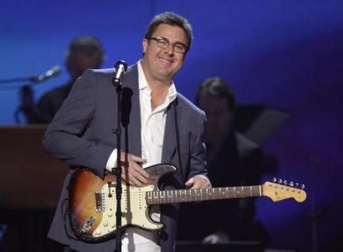 Vince Gill joined Underwood for the duet.