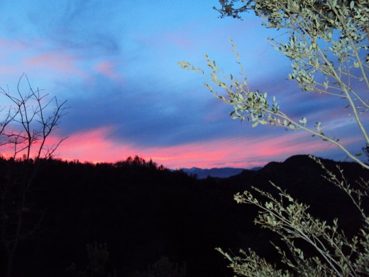 A pink streak in the sky of a sunset up in the San Bernardino Mountains.