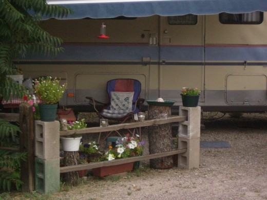 These RV nomads pack all the amenities of home, including a portable garden and humming bird feeder.