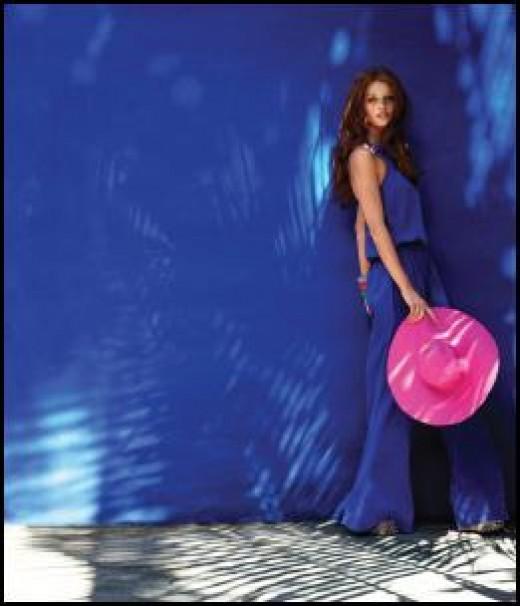model wearing a retro 70's blue  jumpsuit.