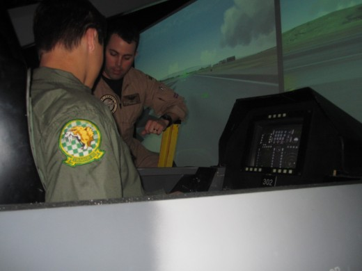 Pre-flight instrument and control orientation in an F-16 flight simulator.