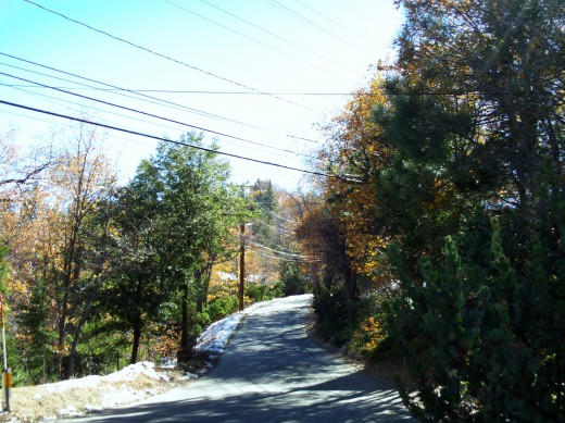 Little patches of snow along the road.