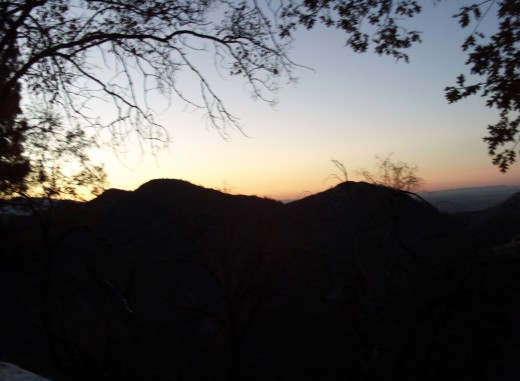 The silhouette of the mountains at sunset.