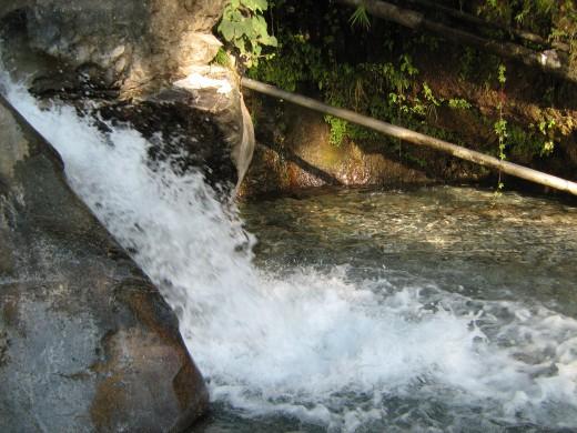 Pure white water falling from Ban Ganga at Mata Vaishno Devi, Jammu, India