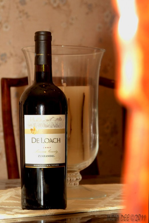 Red wines offer's a ton of antioxidants. Can we get too many in our diets?  Wine bottle with designer candle.