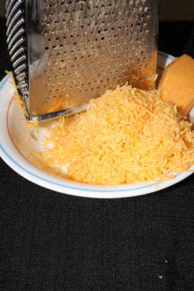 Grate the 2 and 1/2 cups of a good strong cheese